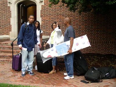 Ready, Set, Go!! A family prepares to move into Dennis Hall.  Does anyone have an iron?