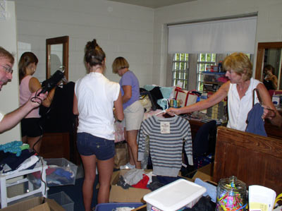 Unpacking, reorganizing and settling in… with all of this practice, these ladies will be ready for whatever comes their way!